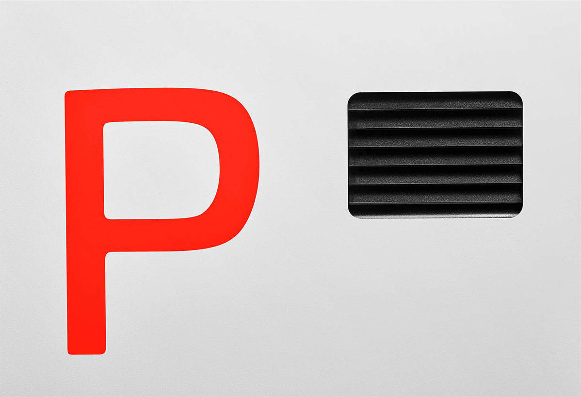 Closeup of parking sign and vent